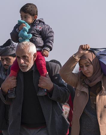Refugiados buscando asilo (iStock)
